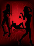 Silhouettes sexy avec le fond rouge Image stock