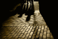 Silhouettes and Shadows of People. Silhouette and shadows of people walking, brick pavement, San Francisco, California Stock Photography