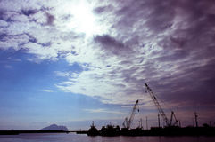 Silhouettes of shipping port Royalty Free Stock Image