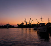 Silhouettes of ships in port Stock Photos