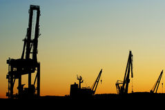 Silhouettes of shipyard cranes Stock Image