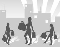 Silhouettes shopping girls on urban background Stock Photography