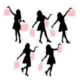 Silhouettes of shopping women Stock Image