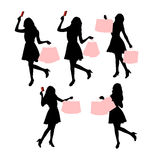 Silhouettes of shopping women Stock Images