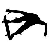 Silhouettes a skateboarder performs jumping. Vector illustration Royalty Free Stock Photography