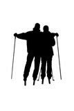 Silhouettes of skiers Stock Photography