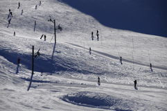 Silhouettes of skiers and tows Stock Photos