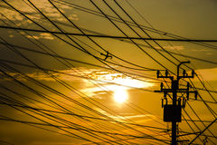 Silhouettes sky contrast with electric toll Stock Image