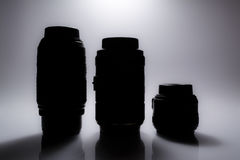 Silhouettes of SLR camera lenses with reflection Royalty Free Stock Image