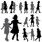 Silhouettes of small girls on the white background Royalty Free Stock Images