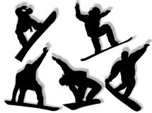 silhouettes snowboarders Arkivfoton