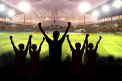 Silhouettes of Soccer fans in a match and Spectators at football. Stadium Royalty Free Stock Photography