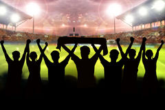 Silhouettes of Soccer fans in a match and Spectators at football. Stadium Stock Photo
