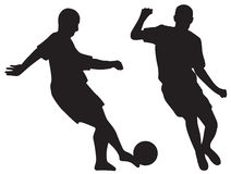 Silhouettes of soccer players Stock Image