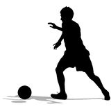 Silhouettes of soccer players with the ball. Royalty Free Stock Image