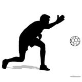 Silhouettes of soccer players with the ball. Stock Images