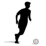 Silhouettes of soccer players with the ball. Royalty Free Stock Images