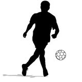 Silhouettes of soccer players with the ball. Royalty Free Stock Photos