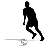 Silhouettes of soccer players with the ball. Stock Photos