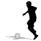Silhouettes of soccer players with the ball. Stock Photo