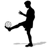 Silhouettes of soccer players with the ball. Stock Image