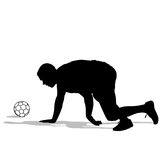 Silhouettes of soccer players with the ball. Royalty Free Stock Photo