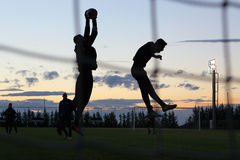 Silhouettes of soccer players Stock Images