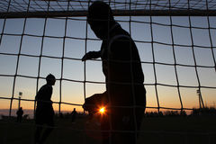 Silhouettes of soccer players Royalty Free Stock Photo