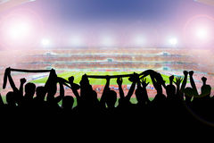 Silhouettes of soccer supporters in stadium Royalty Free Stock Photography