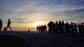 silhouettes solnedgång Arkivfoto