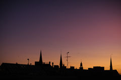 Silhouettes spire of the cathedral with a cock in Riga at sunset Royalty Free Stock Images