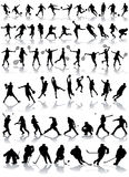 silhouettes sporten Arkivfoto