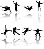 silhouettes sporten Arkivbilder