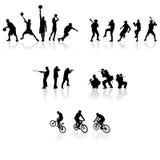 silhouettes sporten Arkivfoton