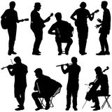 Silhouettes street musicians playing instruments. Vector illustration Stock Image