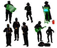 Silhouettes of street performers. Musicians and actors Royalty Free Stock Photos