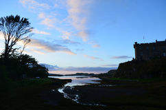 SIlhouettes at Sunrise at Dunvegan Castle in Scotland Royalty Free Stock Image