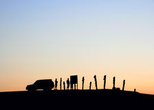 Silhouettes in the sunset. Silhouettes of a car and people on the sky background royalty free stock photos