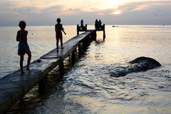 Silhouettes at sunset. Long beach pier. Phu Quoc. Vietnam Royalty Free Stock Images