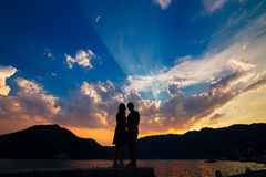 Silhouettes at sunset in Perast Royalty Free Stock Image