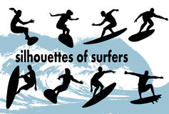 Silhouettes of surfers Royalty Free Stock Photo