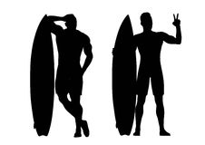 Silhouettes of surfers Royalty Free Stock Images