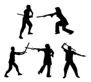 Silhouettes of swordsmen Stock Images