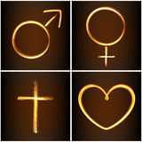 Silhouettes symbols heart, Venus, Mars and cross. Set of silhouettes symbols heart, Venus, Mars and cross in fire-show style Royalty Free Stock Images
