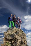 Silhouettes of team on mountain peak. Sport and Royalty Free Stock Images