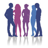 Silhouettes of teenagers talking to each other Royalty Free Stock Images