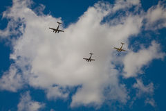 Silhouettes of three Beechcraft airplanes in deep blue sky. During an air show Royalty Free Stock Images