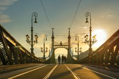 Friends walking on Liberty bridge in Budapest stock images