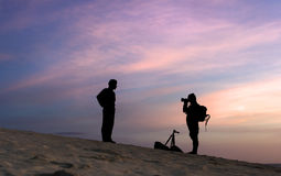 Silhouettes of tourists. On a background of a decline Stock Photo
