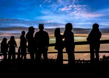 Silhouettes tourists are looking sunrise at view point Stock Photo